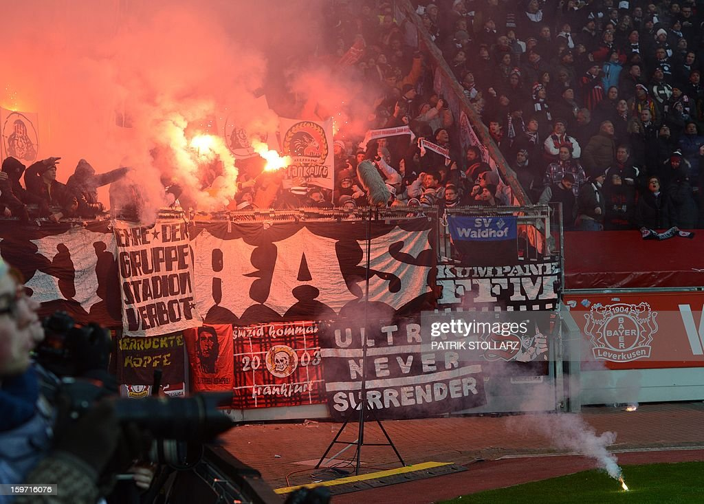 Hooligans burn flares during the German first division Bundesliga football match Bayer Leverkusen vs Eintracht Frankfurt in the German city of Leverkusen on January 19, 2013. AFP PHOTO / PATRIK STOLLARZ