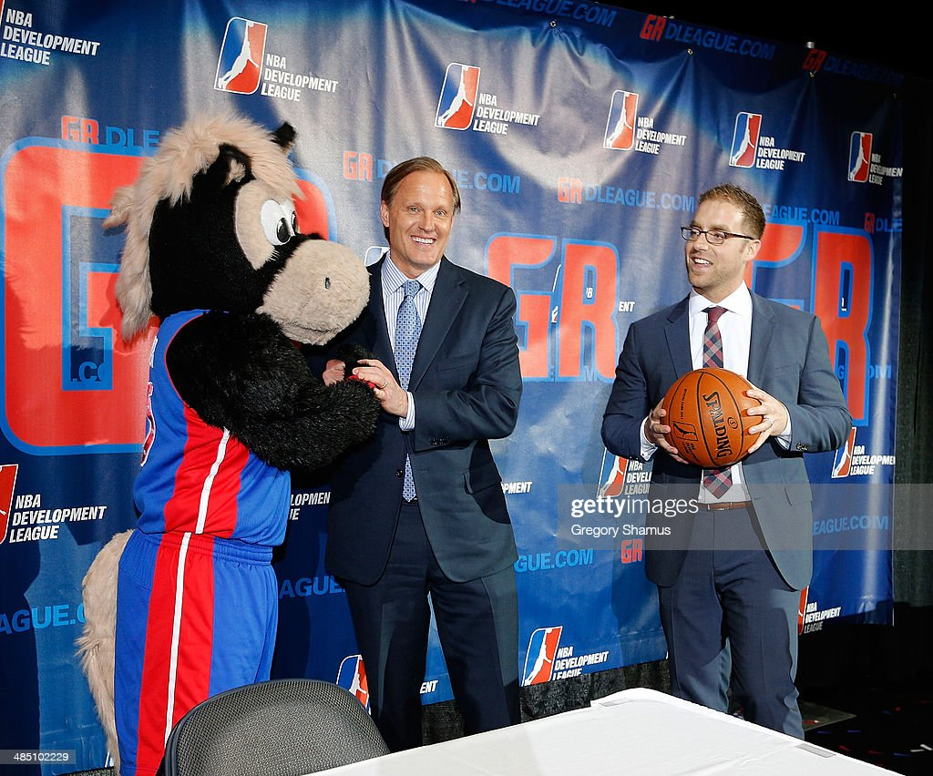 Hooper the Pistons Mascot, Dennis Mannion, CEO of Palace Sports and Entertainment and the Detroit Pistons and Steve Jbara NBA-D League ownership group in Grand Rapids, talk after a press conference to announce a NBA Developmental League franchise relocating to Grand Rapids, Michigan on April 14, 2014 at the DeltaPlex Arena in Grand Rapids, Michigan.