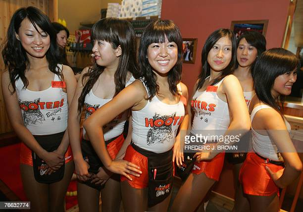 Hooters waitresses await customers at the opening of the US restaurant chain's first outlet in Beijing 10 September 2007 and fourth overall in China...