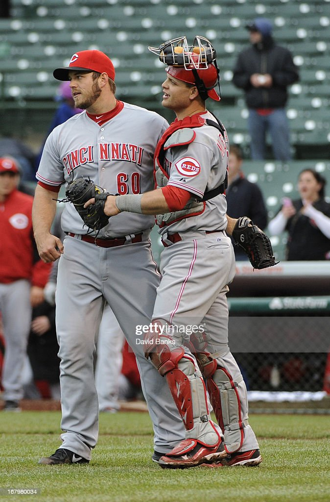 J.J. Hoover #60 of the Cincinnati Reds and <a gi-track='captionPersonalityLinkClicked' href=/galleries/search?phrase=Devin+Mesoraco&family=editorial&specificpeople=5745587 ng-click='$event.stopPropagation()'>Devin Mesoraco</a> #39 celebrate a 6-5 win against the Chicago Cubs on May 3, 2013 at Wrigley Field in Chicago,