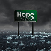 Hope ahead inspirational and motivational life concept as a highway sign drowning in deep flood waters after a hurricane storm as a message of spiritual faith or the promise of recovery and patriotic