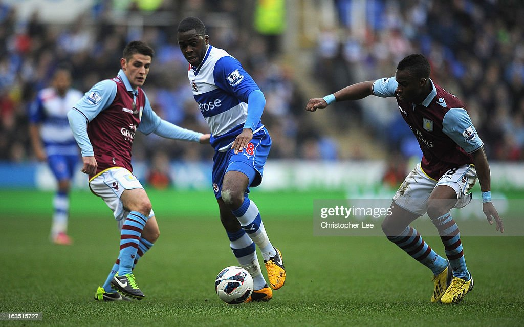 Hope Akpan of Reading battles with Ashley Westwood and Yacouba Sylla of Villa during the Barclays Premier League match between Reading and Aston Villa at Madejski Stadium on March 9, 2013 in Reading, England.