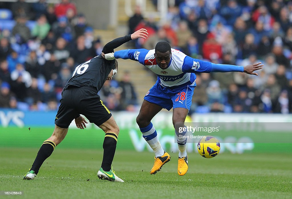 Hope Akpan of Reading in action with James McArthur of Wigan Athletic during the Barclays Premier League match between Reading and Wigan Athletic at Madejski Stadium on February 23, 2013 in Reading, England.