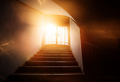 low angle view of stairs with the light of the end of the tunnel, sunlight, hope and spirituality concept.