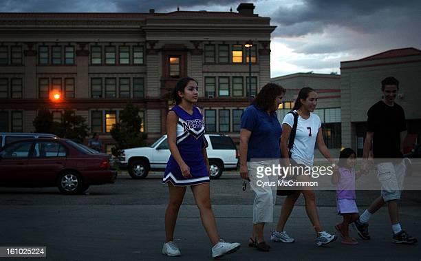 DENVER CO THURSDAY SEPTEMBER 9 2004 Hope HernandezSalazar wife of US Senate candidate Ken Salazar walks to the car with her daughters Andrea Salazar...