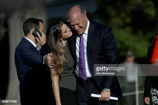 Hope Hicks interim White House Communications Director is greeted by Gary Cohn Director of the National Economic Council before the start of a...
