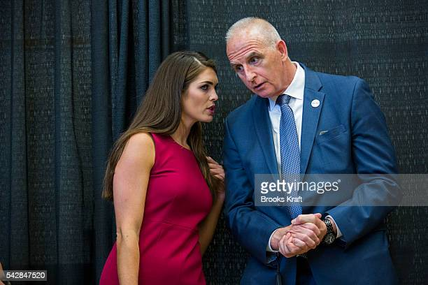 Hope Hicks Republican Presidential candidate Donald Trump's campaign spokeswoman speaks with with head of security Keith Schiller at a campaign event...