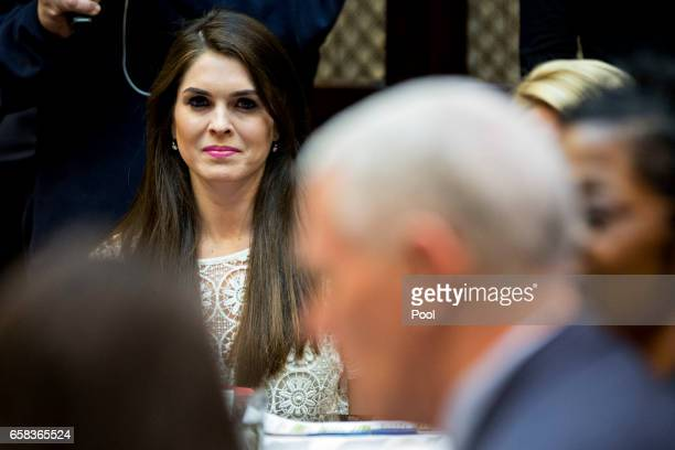Hope Hicks White House director of strategic communications listens while meeting with women small business owners with US President Donald Trump not...