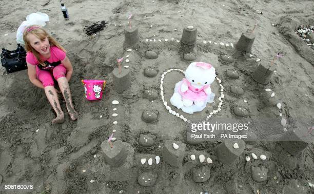 Hope McDonald aged 8 from Carnlough with her castle out of sand on Carnlough beach Co Antrim as part of the Village Festival