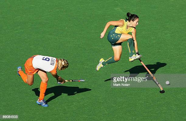 Hope Munro of Australia jumps a pass by Wieke Dijkstra of the Netherlands during the Women's Hockey Champions Trophy match between the Australian...