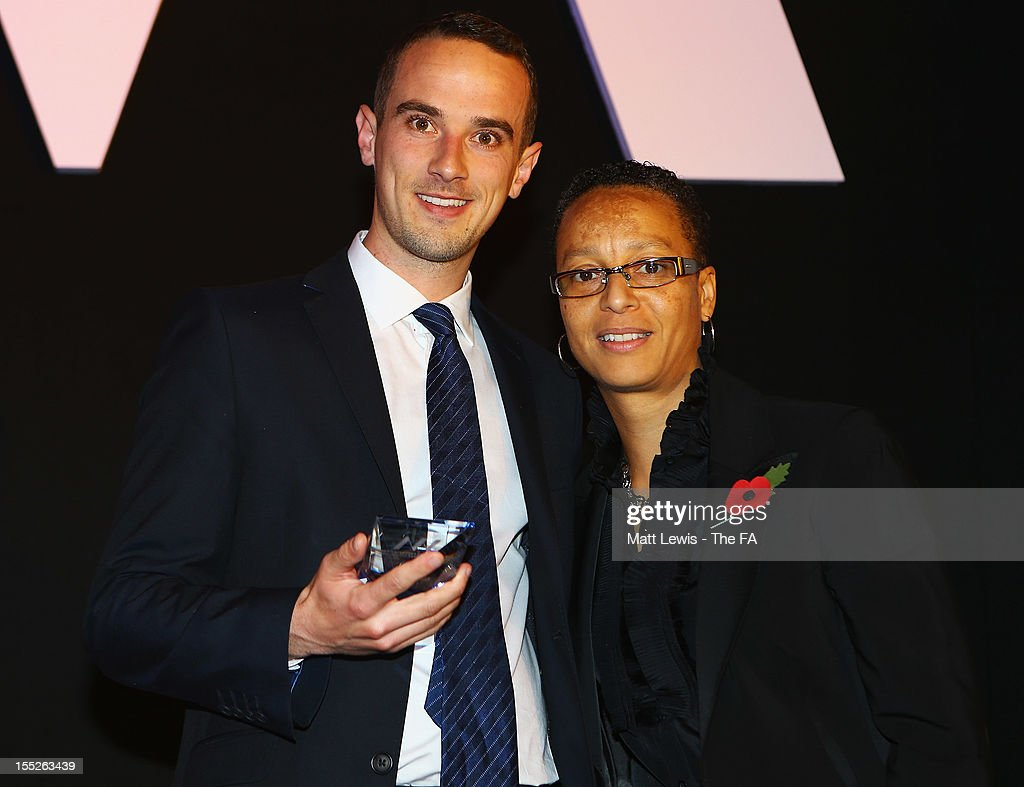 <a gi-track='captionPersonalityLinkClicked' href=/galleries/search?phrase=Hope+Powell&family=editorial&specificpeople=228832 ng-click='$event.stopPropagation()'>Hope Powell</a> presents Mark Sampson of Bristol Academy WFC with the 'FA WSL Coach of the Year' award during the FA Women's Awards 2012 at the Waldorf Hilton on November 2, 2012 in London, England.