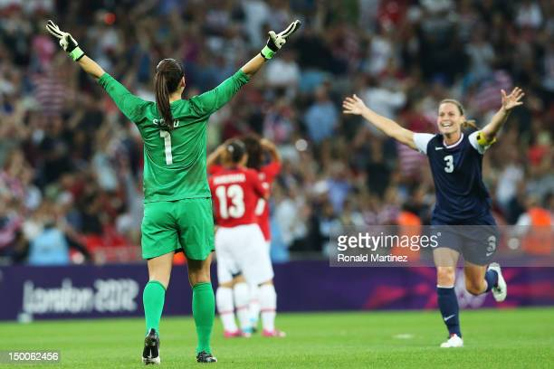 Hope Solo and Christie Rampone of the United States celebrate after defeating Japan by a score of 21 to win the Women's Football gold medal match on...