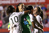 Hope Solo of the United States celebrates with Carli Lloyd after defeating China 10 in the FIFA Women's World Cup 2015 Quarter Final match at...