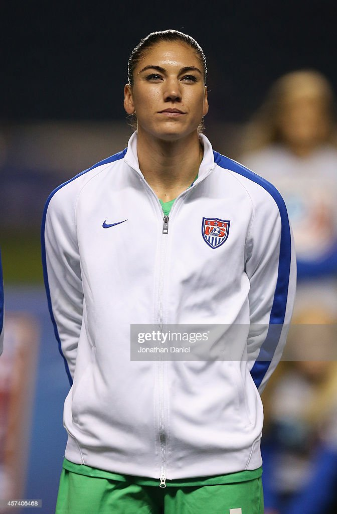 Hope Solo #1 of the United States stands during the National Anthem before a match against Guatemala during the 2014 CONCACAF Women's Championship at Toyota Park on October 17, 2014 in Bridgeview, Illinois. The United States defeated Guatemala 5-0.
