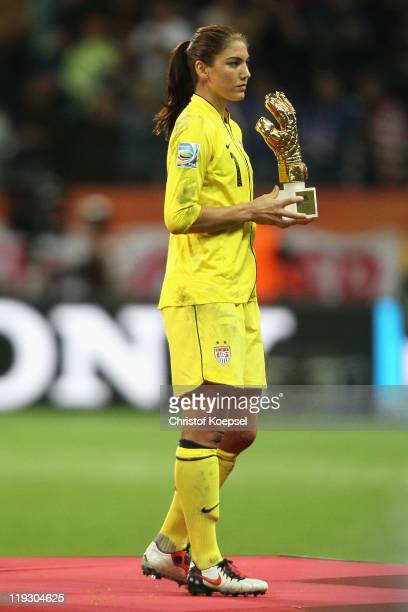 Hope Solo of USA holds the golden glove on the podium after the FIFA Women's World Cup Final match between Japan and USA at the FIFA World Cup...