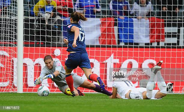 Hope Solo of USA saves at the feet of Gaetane Thiney of France during the FIFA Women's World Cup 2011 Semi Final between France and USA at...