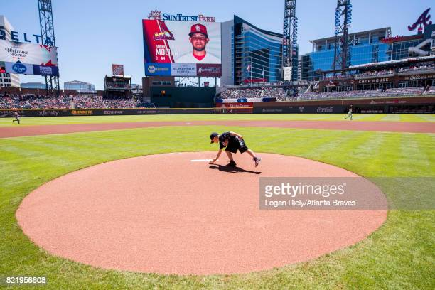 Hopewell Youth member delivers the rosin bag before the game against the St Louis Cardinals at SunTrust Park on May 7 2017 in Atlanta Georgia The...