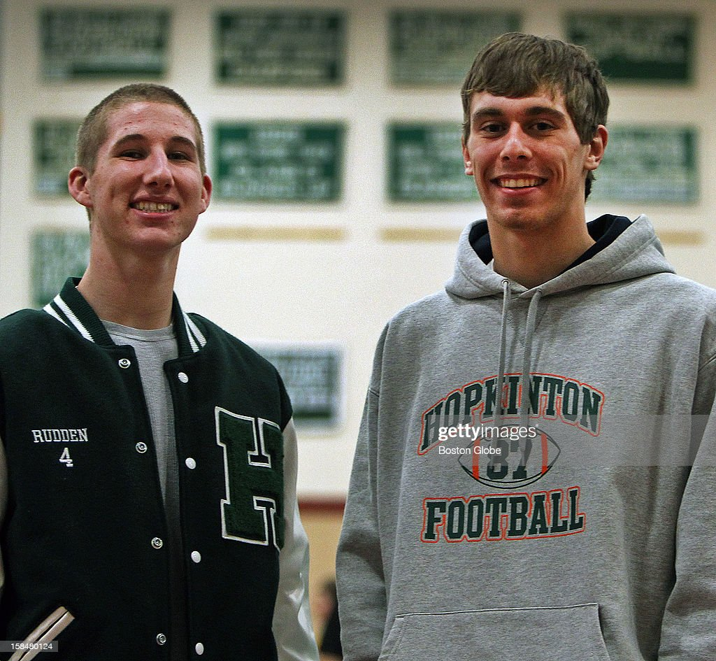 Hopkinton High School football players Hank Rudden, left, and Shaun Palmer, right, pose together in the school's gymnasium.