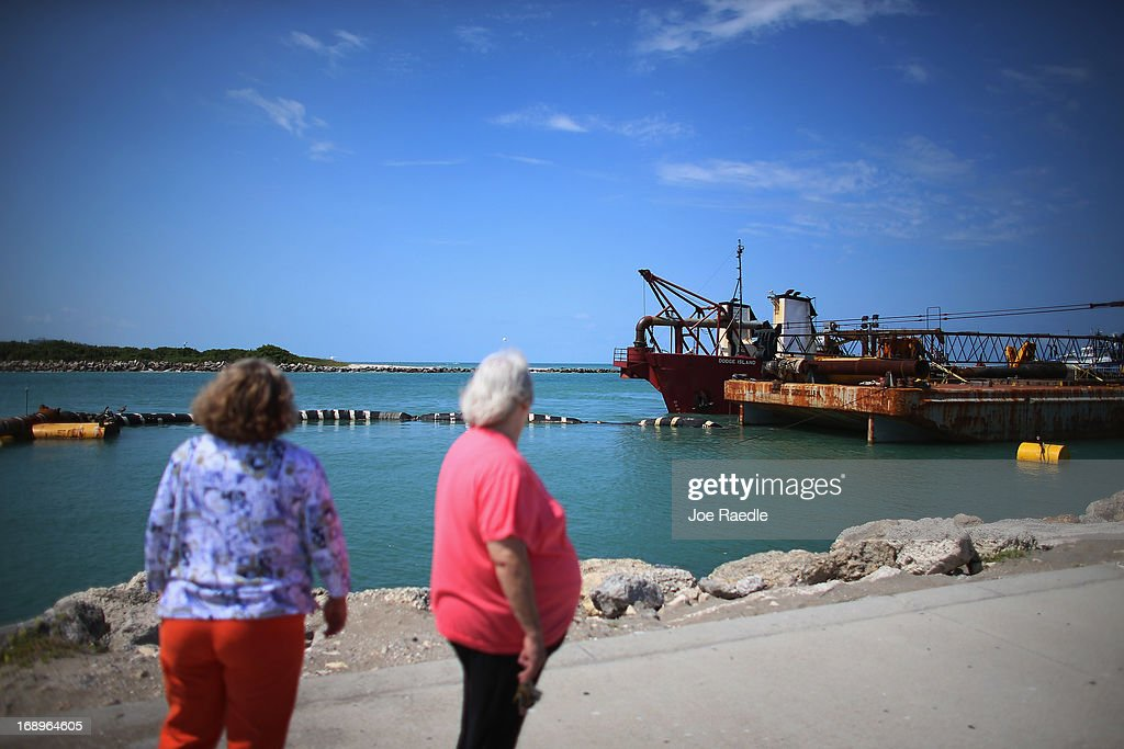 A hopper dredging boat prepares to hook up to a discharge pipe to carry dredged sand into place during a federally funded shore protection project by Great Lakes Dredge and Dock on May 17, 2013 in Fort Pierce, Florida. As cities along the East Coast prepare for the start of the hurricane season, officials say the area encompasing Fort Pierce beach has been in dire need of repair since Hurricane Sandy last year made worse an area already suffering significantly from erosion. Some experts say shore restoration projects can help reduce the physical and economic damage from waves, storm surge, and the resulting coastal flooding in a hurricane.