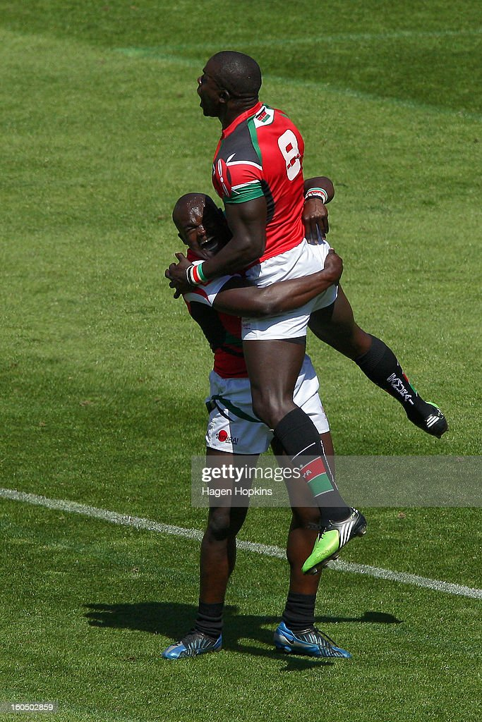 Horace Otieno of Kenya and teammate Andrew Amonde celebrate the win at the final whistle in the quarterfinal cup match between Kenya and South Africa during the 2013 Wellington Sevens at Westpac Stadium on February 2, 2013 in Wellington, New Zealand.