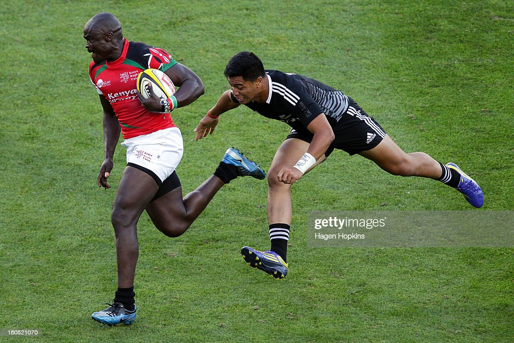 Horace Otieno of Kenya is tackled by Rocky Khan of the All Blacks Sevens in the semifinal cup match between New Zealand and Kenya during the 2013 Wellington Sevens at Westpac Stadium on February 2, 2013 in Wellington, New Zealand.