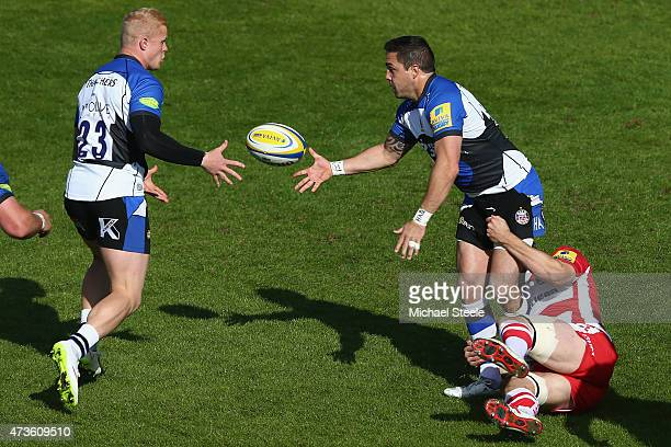 Horacio Agulla of Bath ofloads to Tom Homer during the Aviva Premiership match between Bath Rugby and Gloucester Rugby at the Recreation Ground on...