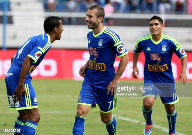 Horacio Calcaterra of Sporting Cristal celebrates a scored goal with his teammates against Real Garcilaso as part of the Copa Inca at Municipal de...