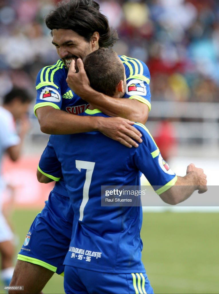 Horacio Calcaterra of Sporting Cristal celebrates a scored goal with his teammates against Real Garcilaso as part of the Copa Inca at Municipal de Urcos Stadium on Februay 15, 2014 in Cuzco, Peru.