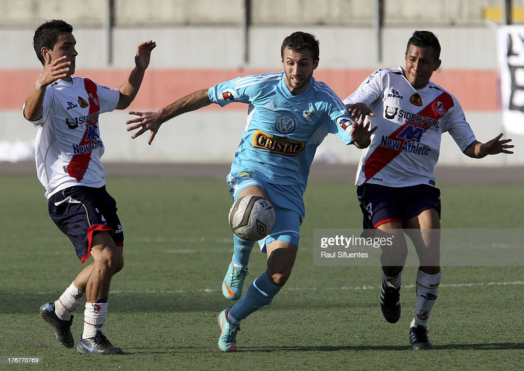 Horacio Calcaterra (C) of Sporting Cristal fights for the ball with Ricardo Salcedo (L) and Manuel Tejada (R) of Jose Galvez during a match between Jose Galvez and Sporting Cristal as part of The Torneo Descentralizado 2013 at the Estadio Manuel Rivera Sanchez on August 18, 2013 in Chimbote, Peru.
