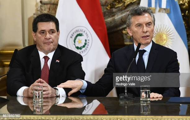 Horacio Cartes president of Paraguay and Mauricio Macri president of Argentina answer questions to media during a press conference at Casa Rosada as...