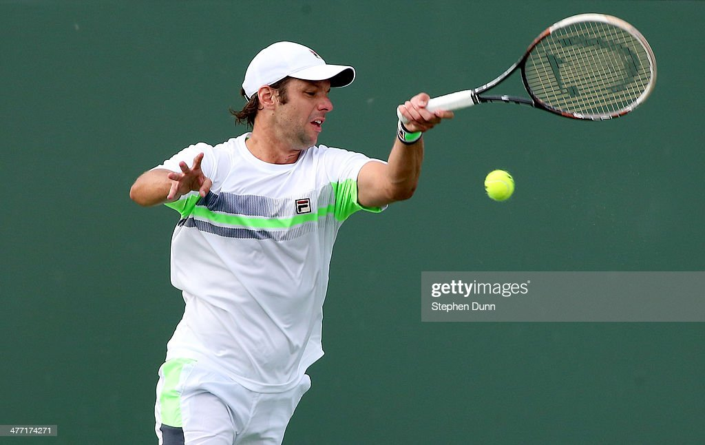 Horacio Ceballos of Argentina hits a return to Rajeev Ram during the BNP Paribas Open at Indian Wells Tennis Garden on March 7, 2014 in Indian Wells, California.