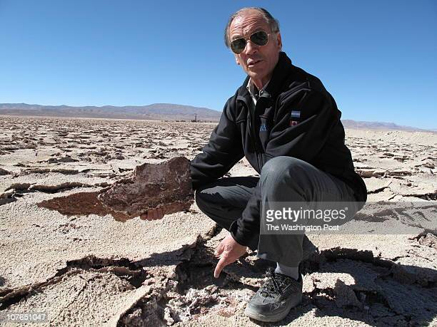 Horacio Dias a geologist and manager for the mining company Exar points to the moonscapelike environment high in the Andes where his Canadianowned...