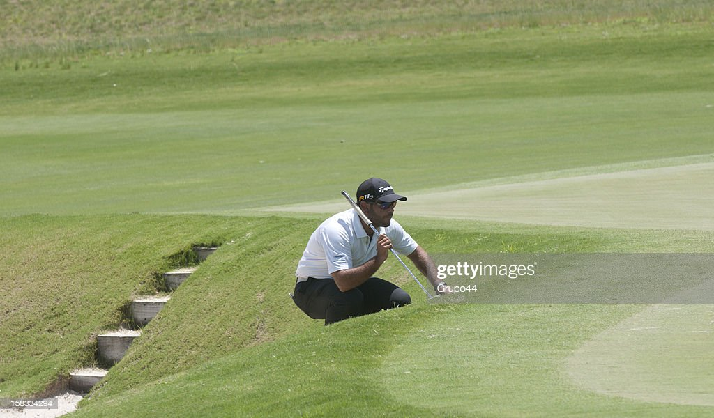 Horacio Leon of Chile reads the green during the opening day of the 107 Visa Golf Open presented by Peugeot as part of the PGA Latin America at Nordelta Golf Club on December 13, 2012 in Buenos Aires, Argentina.