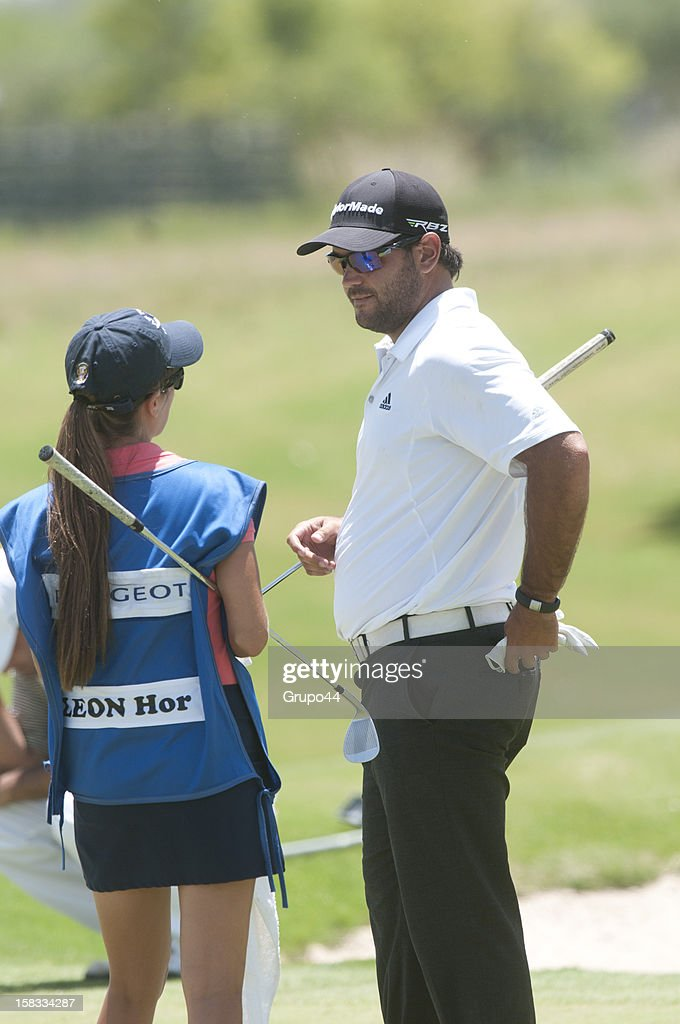 Horacio Leon of Chile talks to the caddy during the opening day of the 107 Visa Golf Open presented by Peugeot as part of the PGA Latin America at Nordelta Golf Club on December 13, 2012 in Buenos Aires, Argentina.