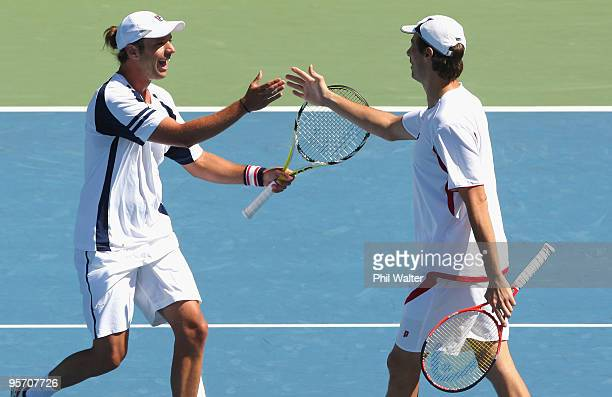 Horacio Zeballos of Argentina and Rogier Wassen of the Netherlands celebrate following their first round doubles match against Bob Bryan and Mike...