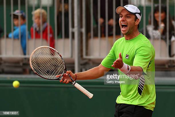 Horacio Zeballos of Argentina celebrates in his Men's Singles match against Vasek Pospisil of Canada during day four of the French Open at Roland...