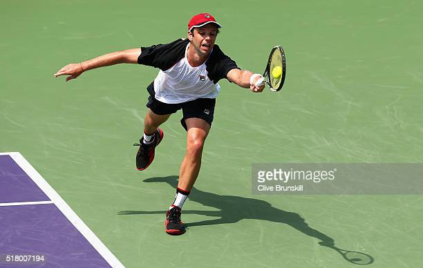 Horacio Zeballos of Argentina plays a forehand against David Goffin of Belgium in their fourth round match during the Miami Open Presented by Itau at...