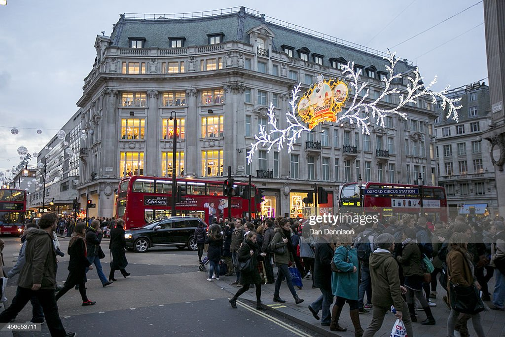 Hordes of Christmas shoppers walk beneath festive lights on Regent Street on December 14 2013 in London England As Christmas Day approaches London's...