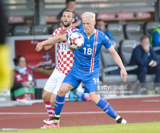 Hordur Magnusson of Iceland and Marcelo Brozovic of Croatia vie for the ball during the FIFA World Cup 2018 qualification football match between...