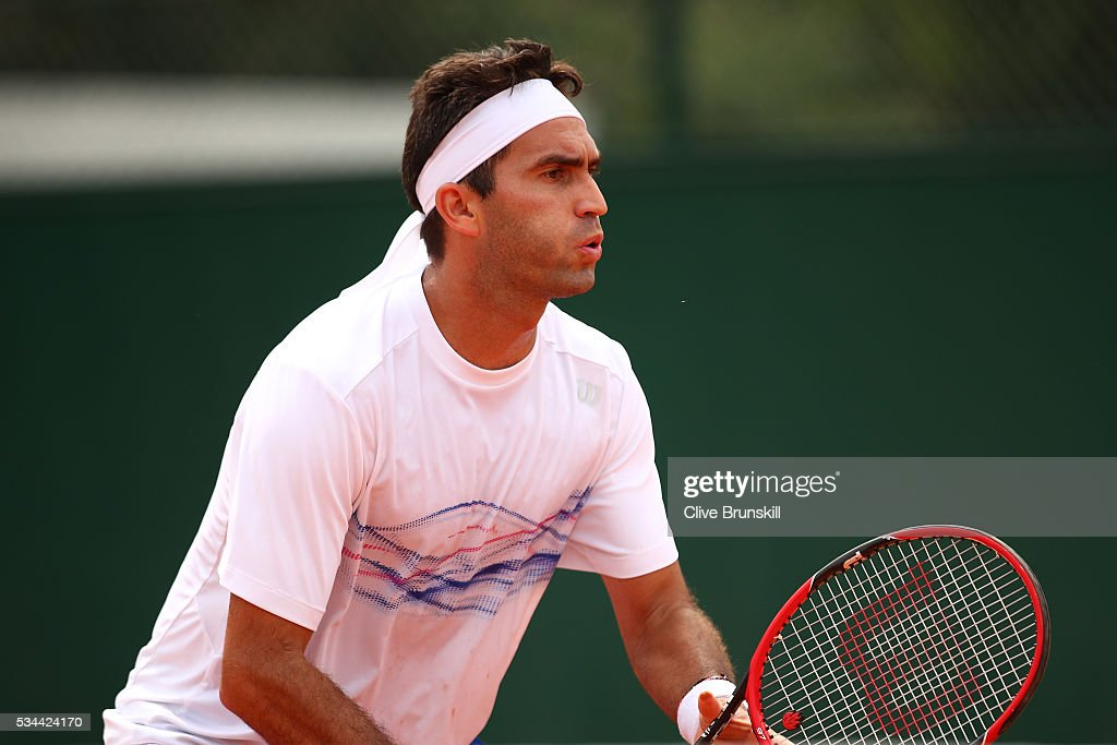 <a gi-track='captionPersonalityLinkClicked' href=/galleries/search?phrase=Horia+Tecau&family=editorial&specificpeople=820211 ng-click='$event.stopPropagation()'>Horia Tecau</a> of Romania awaits a serve during the Men's Doubles first round match against Guido Pella and Horacio Zeballos of Argentina on day five of the 2016 French Open at Roland Garros on May 26, 2016 in Paris, France.