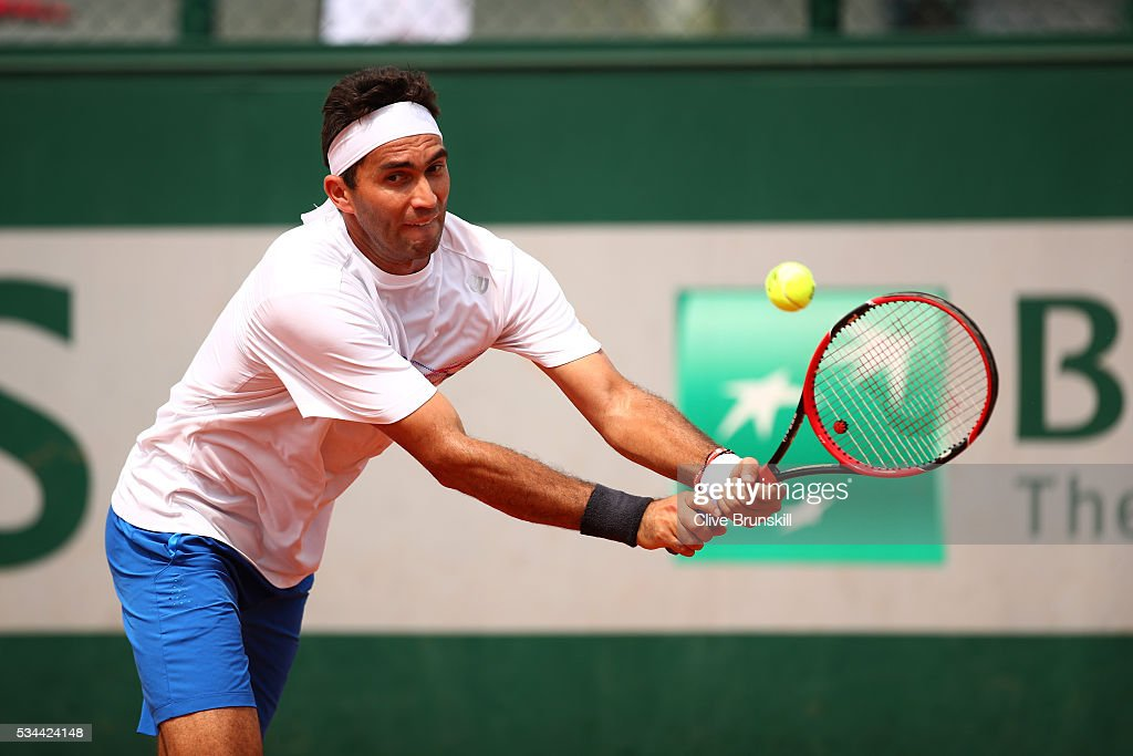 <a gi-track='captionPersonalityLinkClicked' href=/galleries/search?phrase=Horia+Tecau&family=editorial&specificpeople=820211 ng-click='$event.stopPropagation()'>Horia Tecau</a> of Romania hits a backhand during the Men's Doubles first round match against Guido Pella and Horacio Zeballos of Argentina on day five of the 2016 French Open at Roland Garros on May 26, 2016 in Paris, France.