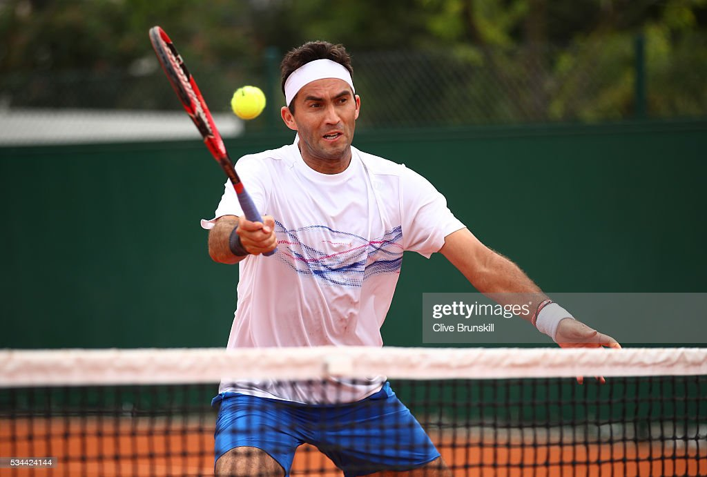 <a gi-track='captionPersonalityLinkClicked' href=/galleries/search?phrase=Horia+Tecau&family=editorial&specificpeople=820211 ng-click='$event.stopPropagation()'>Horia Tecau</a> of Romania hits a forehand during the Men's Doubles first round match against Guido Pella and Horacio Zeballos of Argentina on day five of the 2016 French Open at Roland Garros on May 26, 2016 in Paris, France.
