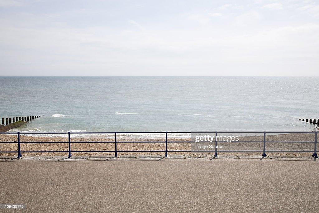 Horizon over sea and promenade : Stock Photo