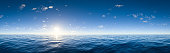 Digitally generated panoramic view of endless deep blue ocean with beautiful sky.