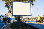 horizontal blank billboard on the city street in background buildings and road with cars mock up