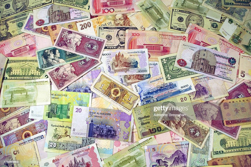 CONTENT] Horizontal shot of colorful banknotes in different denominations from around the world Countries represented include the United States of...
