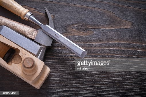 Horizontal version of claw hammer shaving plane and chisels on : Stock Photo