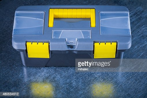 Horizontal version of closed toolkit on scratched metallic backg : Stock Photo