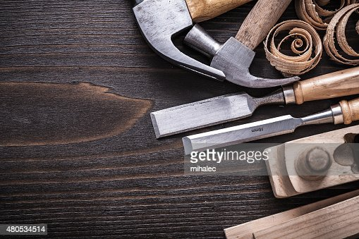 Horizontal version of planer hammer metal chisels wooden studs a : Stockfoto