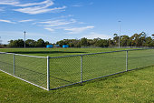 Horizontal view of an empty sports oval. Other related images: